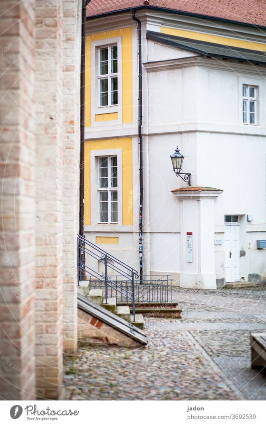 stairs to the courtyard. Stairs Facade Exterior shot Deserted Wall (building) Wall (barrier) Colour photo Architecture Manmade structures built Town