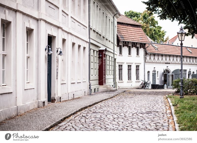 empty streets (26). Street Facade House (Residential Structure) Paving stone Exterior shot Deserted Colour photo Wall (barrier) Town Architecture