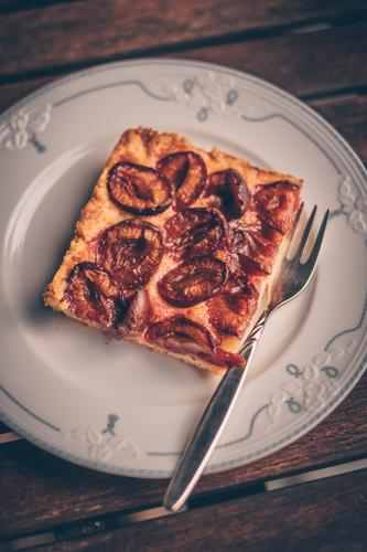 A piece of plum-dachi on a plate at grandma's plum dachshis plum cake Cake Delicious Table squiggled vintage Old fashioned Baked goods homemade Plums