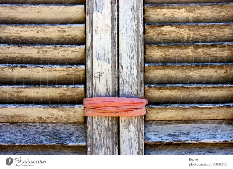brown wood venetian blind and a pink rope in colon Rope Line Dirty Blue Brown Yellow Gray Green Pink Black White colonia del sacramento Uruguay Shutter window