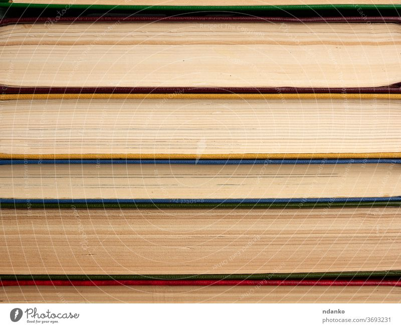stack of various books, abstract backdrop knowledge information paper study background texture read library literature education research university textbook