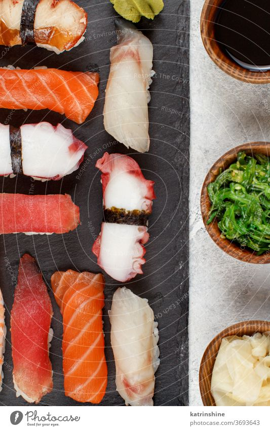 Sushi Set, nigiri on a plate sushi ready to eat eating Sashimi sushi bar dinning Japanese Culture Seafood top view Roll Asian Prawn Tuna Soy Ginger grey Cuisine