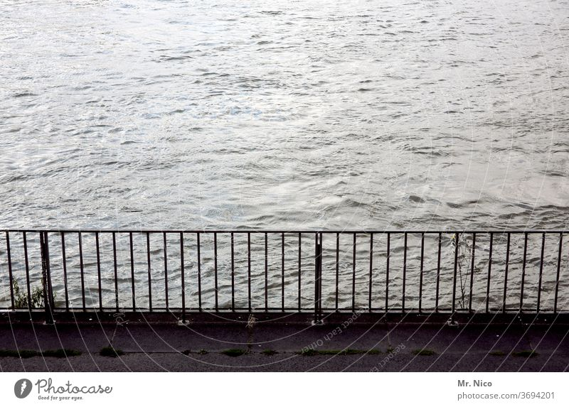handrail at the waterfront Water River Handrail Safety Metal demarcation bank River bank Grating Body of water Flow Lake Waves Footbridge parapet Protection