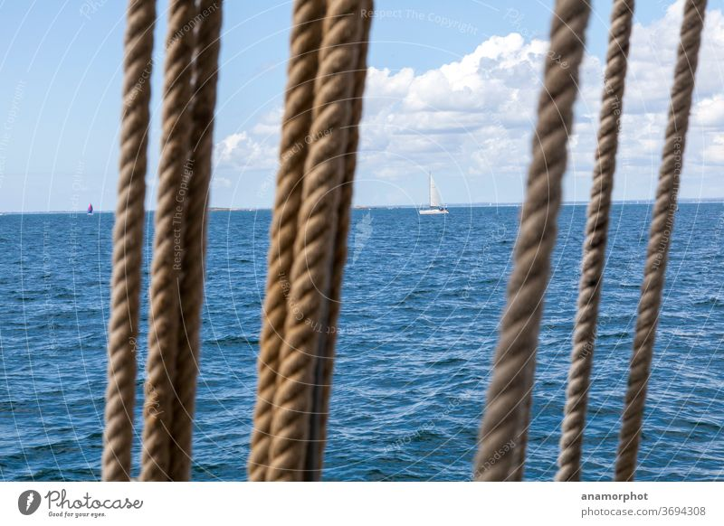 Rigging in front of sailboats on the horizon Ocean Lake Water Blue Sky Horizon Clouds Vacation & Travel Calm Deserted Colour photo Waves Exterior shot Freedom