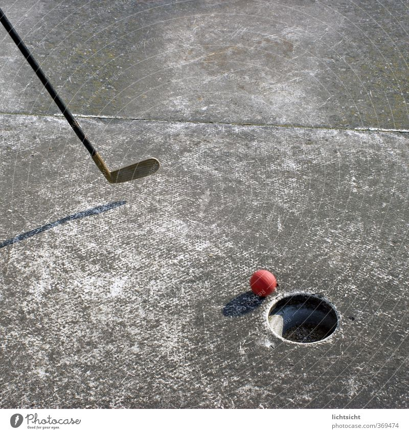 Aim of the game Leisure and hobbies Playing Mini golf Stone Concrete Sphere Gray Red Sports Golf club Bat sports Ball Hollow Beat Confine Blow Mini golfclub
