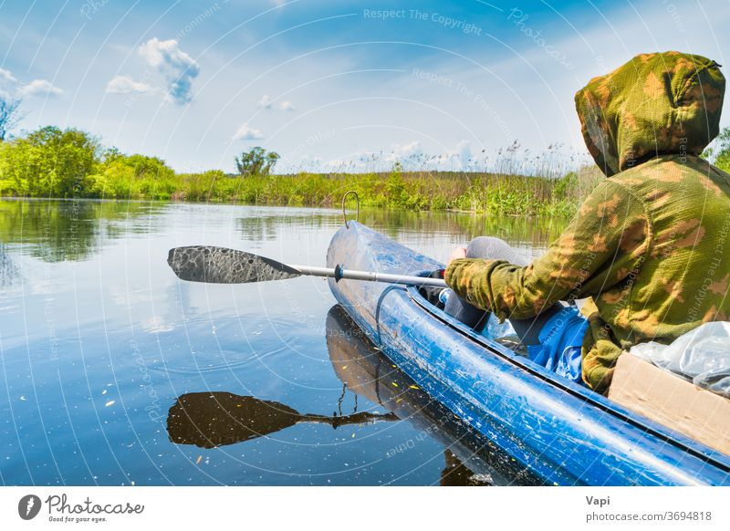 Couple at kayak trip on blue river man people water canoe nature tree forest cloud calm sky travel landscape green summer view outdoor beautiful natural