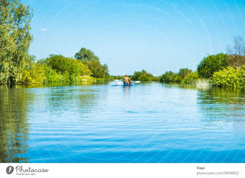 Couple at kayak trip on blue river landscape people water canoe nature tree forest cloud calm sky travel green summer view outdoor beautiful natural environment