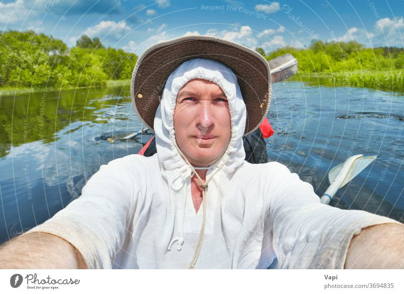 Smiling man taking selfie photo on kayak water river fun smiling man canoe summer adventure outdoor sport young vacation nature people lifestyle travel activity