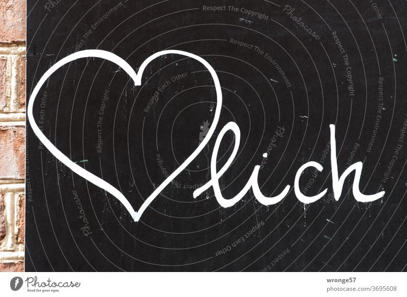 Cordially painted with white chalk on a black board Heart Sincere Blackboard black panel display Colour photo Chalk black background Deserted White Write