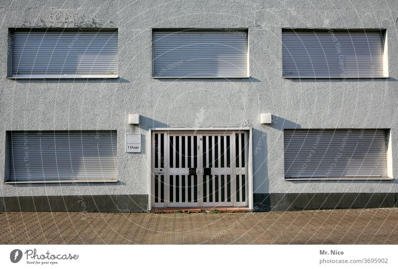 5 windows and one door Facade Window House (Residential Structure) Building Architecture roller shutter Shadow Apartment house nobody there nobody at home