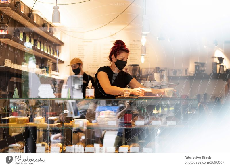Waiter and waitress working in coffee shop barista prepare together coworker counter coronavirus mask new normal cafe delicious busy drink beverage cozy
