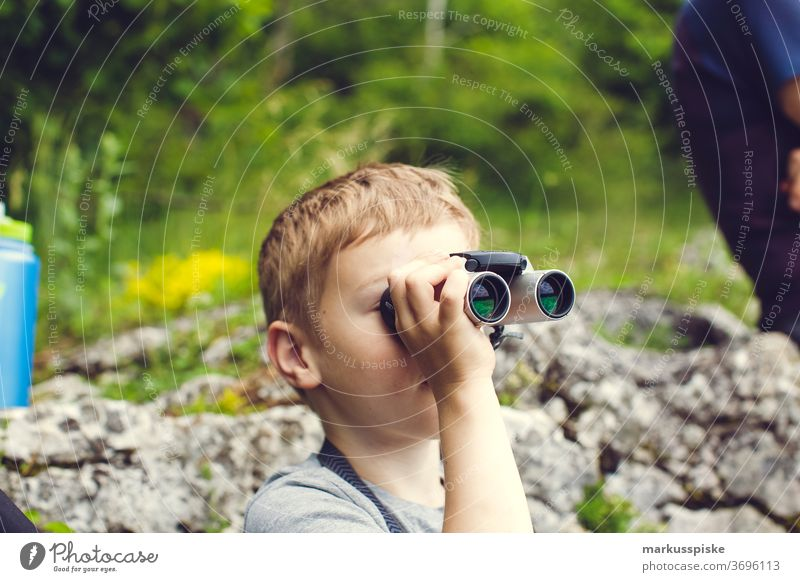Boy with binoculars Boy (child) Child Infancy Adventure Discover explorers far vision Binoculars Future utopia Positive Optimism