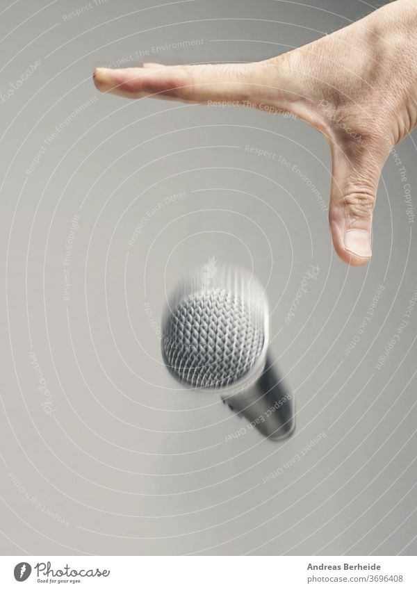 Speaker drops his microphone at the end of the speech. Mic drop concept. symbol political conceptual business expression figurative triumph performance gesture
