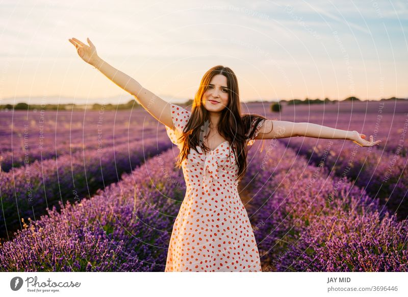Happy woman in a dress and with open arms in lavender field. beautiful happiness lavander freedom smile young nature purple spring model summer hair people