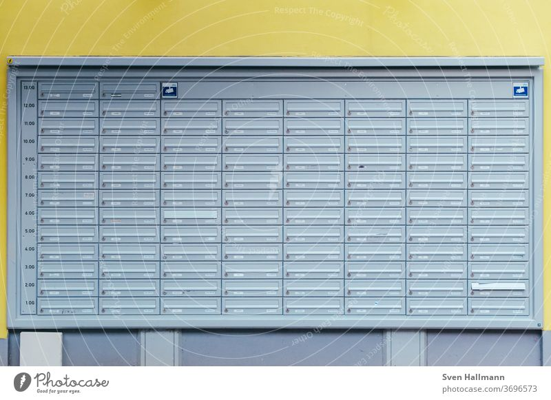 many mailboxes in front of yellow wall Mailbox Metal Colour photo Deserted Slit Communicate Exterior shot Letter (Mail) Flap High-rise Anonymous