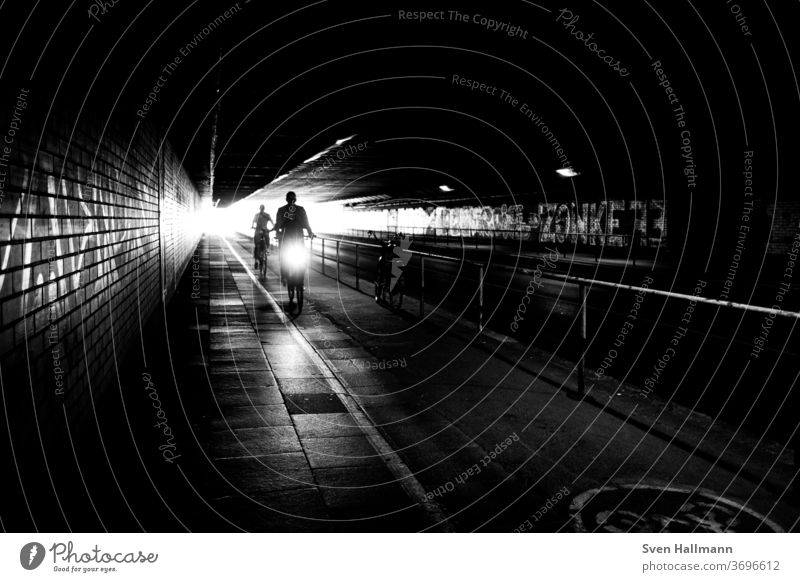 Cyclists in the tunnel Transport City Speed Exterior shot Driving Trip Shadow play Street urban Lifestyle Cycling Movement Art Sports cyclists tutorial Bicycle