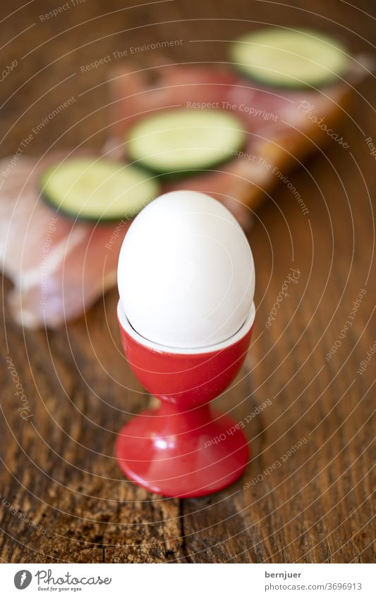 boiled egg and bread with ham Egg Egg cup Close-up Eating ham sandwich Bread Fresh Breakfast salubriously background single one seethed natural Protein White