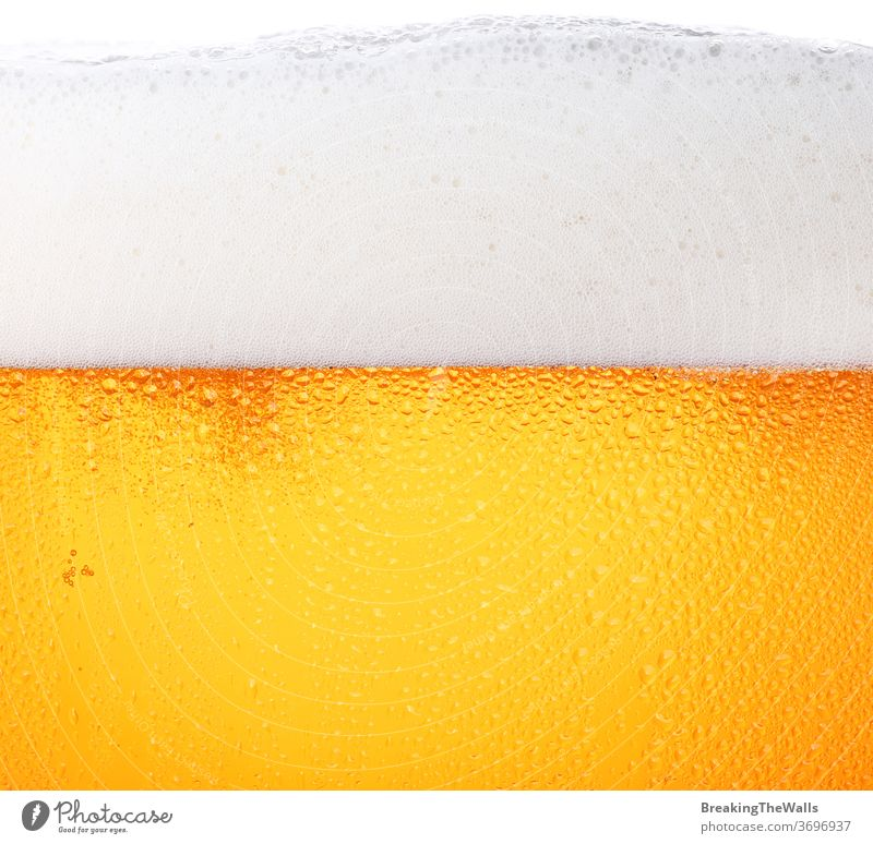 Close up background of beer with bubbles in glass Beer froth closeup pouring frosty fresh lager drops ale side view low angle texture mug large big white orange