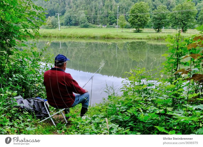 Angler sitting on the riverbank in the green Fishing (Angle) Water Fisherman sit in River River bank shrubby Forest Relaxation silent tranquillity Catch fish
