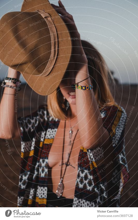 Boho girl in the country side in a moon sky background female lonely looking wind sunrise concept impossible come true vacation storm people lifestyle horizon
