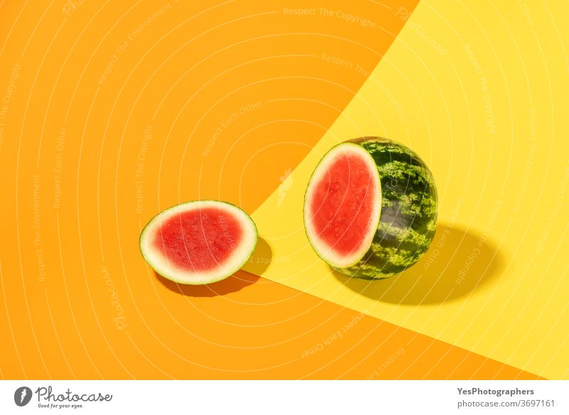 Watermelon isolated on colorful abstract background. Sliced watermelon creative layout bright colored cut cut out deck detox diet food fresh fruits green