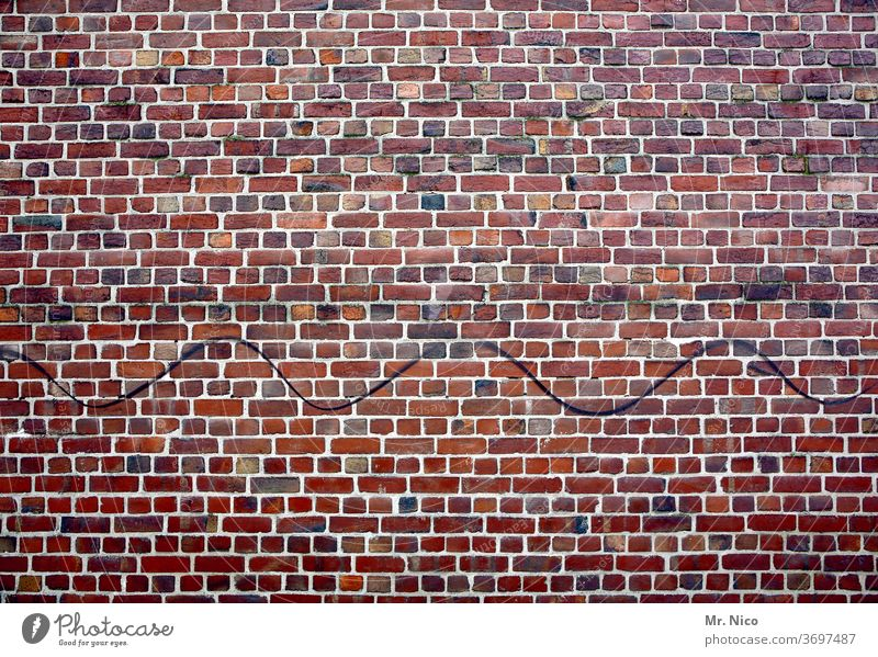 Wavy line on a brick wall Wall (building) Wall (barrier) Brick wall House (Residential Structure) masonry Old building Facade Structures and shapes bricks Red