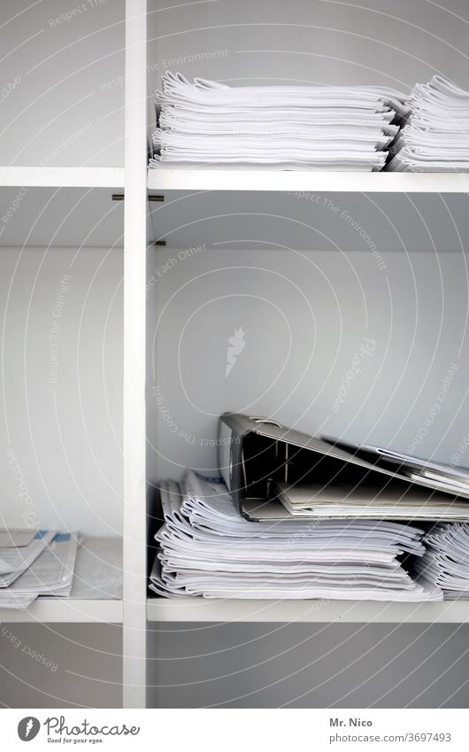 Papers and folders are stored in an office cabinet Shelves White file Workplace File Arrange Accountancy Work and employment file files Cupboard Data Business
