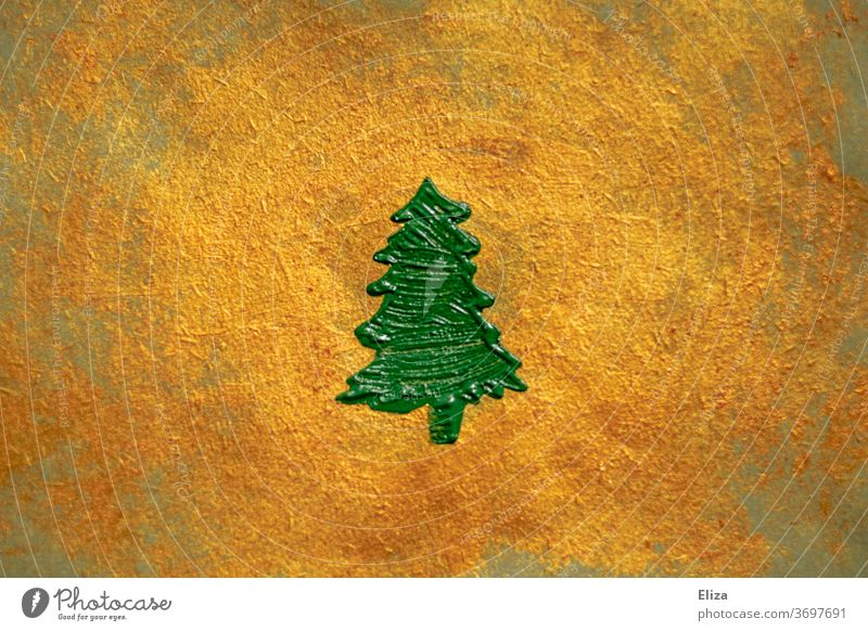 green painted fir tree on a gold shimmering background. Christmas. Fir tree Gold golden christmas tree Noble Decoration texture Christmas & Advent Painted