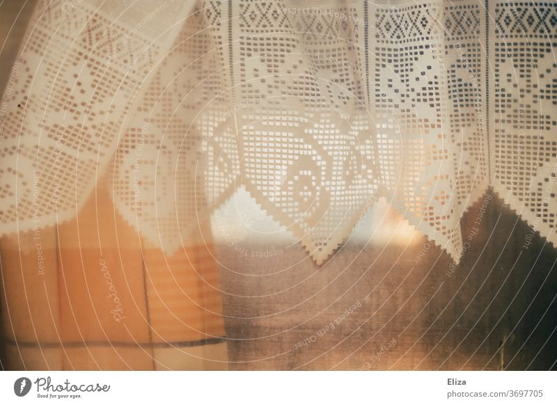Caravan romance. Window of a caravan with lace curtains. Point stale Retro atmospheric Misted up Dreary Drape Curtain Living or residing Cloth White