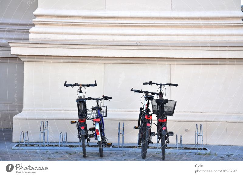 Classical modernity Bicycle Column Cacique classicistic Bicycle rack bicycles Parking area Parking lot Bike baskets Deserted Exterior shot Transport