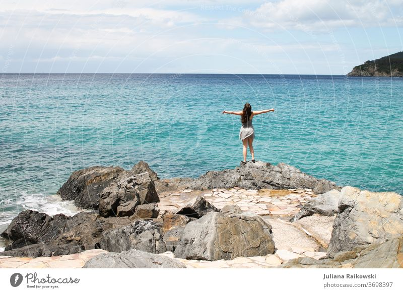 Woman on the coast vacation Vacation & Travel Beach Ocean Water Summer Waves Coast Sky Relaxation Horizon Nature Landscape Freedom Beautiful weather Island