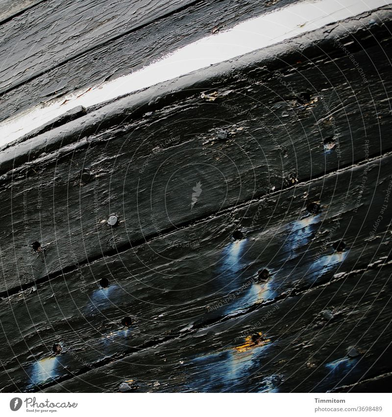 Can a ship on land mourn? Bow wood planks holes colour traces Old Tears Black White cracks wear Deserted Detail Paintwork