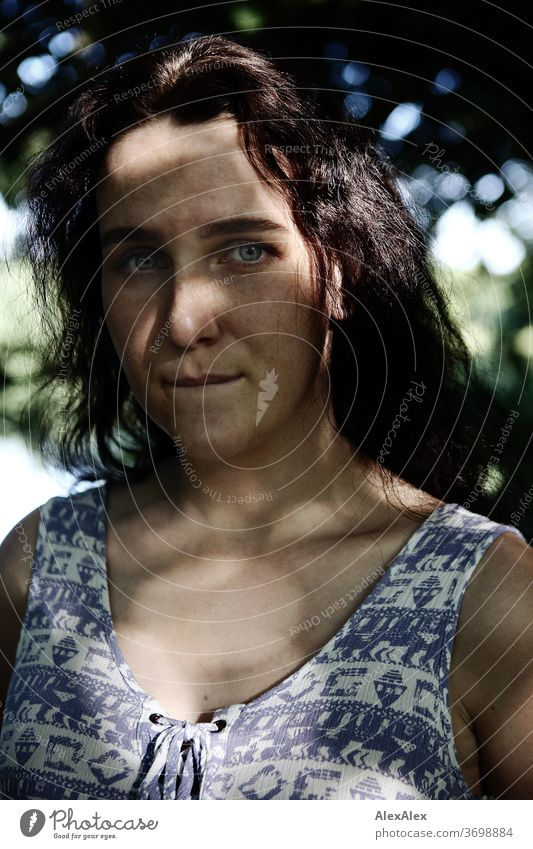 Close portrait of a freckled woman in a forest in summer Delicate Shadow Light Athletic Feminine empathy Emotions emotionally Looking into the camera