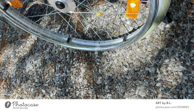 Wheel with reflectors from a wheelchair on pavement slabs Tire Wheelchair aids locomotion Spokes Footpath off