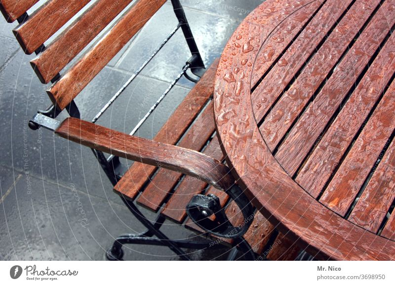 Left out in the rain Table Chair wood Furniture Seating Backrest Wooden chair Brown Wet raindrops Outdoor furniture Beer garden outside gastronomy Terrace