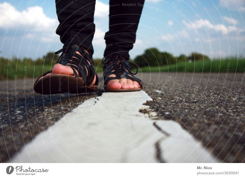 ON SOFT SOLES To go for a walk stroll Street Going Lanes & trails Walking pedestrian Legs Footwear Sandals Fashion Movement feet Asphalt Lane markings