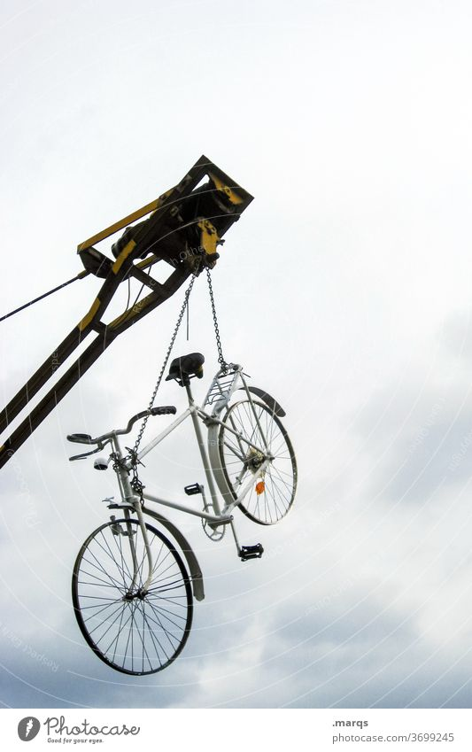Counterweight | wheel to crane Bicycle Crane Hang Sky Clouds Construction site Construction crane Tall