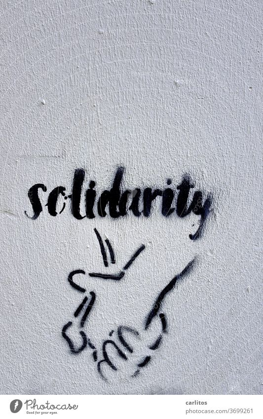 Hand in Hand I Graffiti Solidarity embassy Wall (building) Black Characters Letters (alphabet) writing Typography Text Copy Space top Signs and labeling
