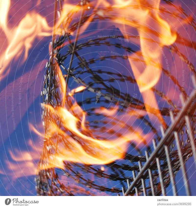 Hot iron - do not tackle Fence Barbed wire Fire Burn cordon Confine jail Storage interdiction Blaze Flame Warmth Yellow Red Blue peril Safety insecurity Orange