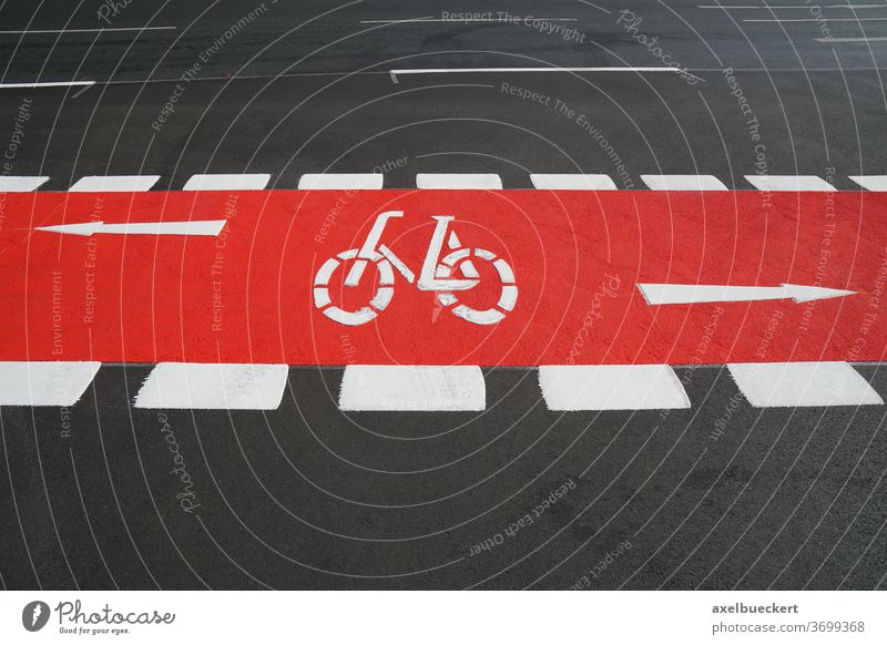 bike lane painted red bicycle path cycleway cycling track traffic street road designated city symbol transport biking travel asphalt safety transportation