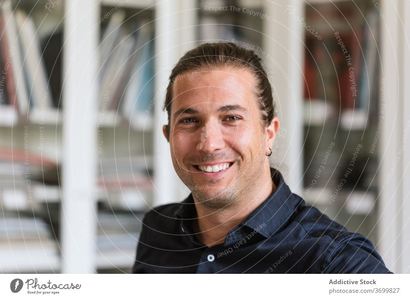 Smiling man in bright office worker workspace contemporary job content table male smiling modern formal business workplace handsome manager career executive