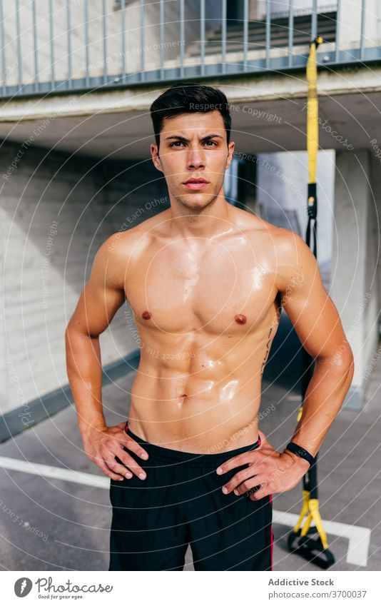Strong sportsman with sweaty body on street muscular training workout strong shirtless male athlete healthy fitness wellness confident power sportswear