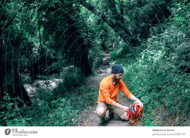 Traveler with backpack in forest travel vacation man woods beard trail green tourist male calm tourism journey trip traveler summer holiday relax nature guy