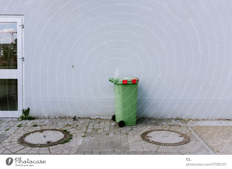 Green barrel Green trash can Trash Trash container Waste management refuse collection dustbin Gloomy Wall (building) Gully green Environmental protection