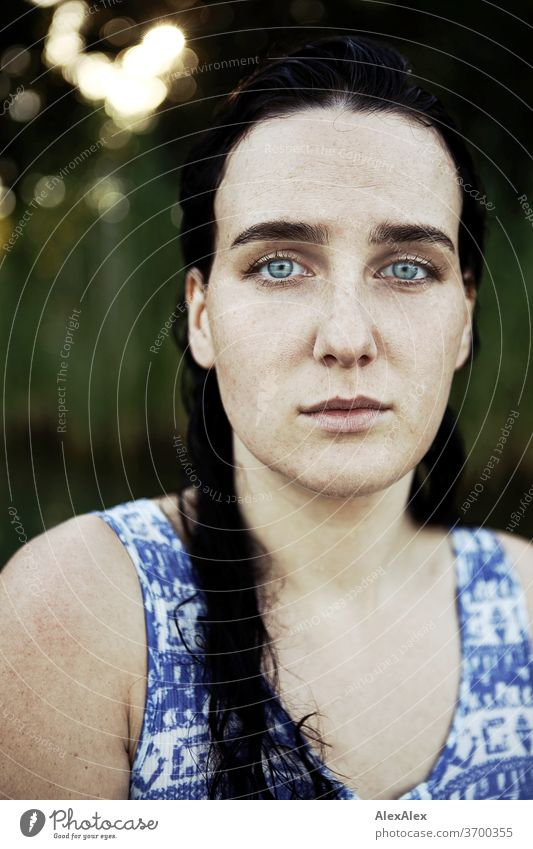 Close portrait of a freckled woman with wet hair in a lake in front of reeds Delicate Light Athletic Feminine empathy Emotions emotionally