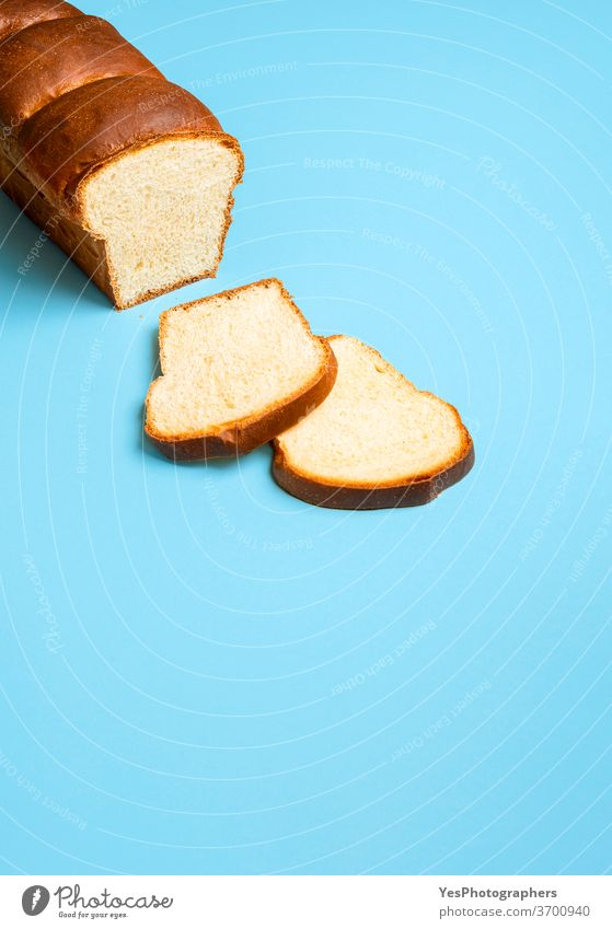 Sourdough sandwich bread on a blue table. Homemade Hokkaido milk bread baked bakery baking blue background brioche butter copy space crust cuisine cut out eat
