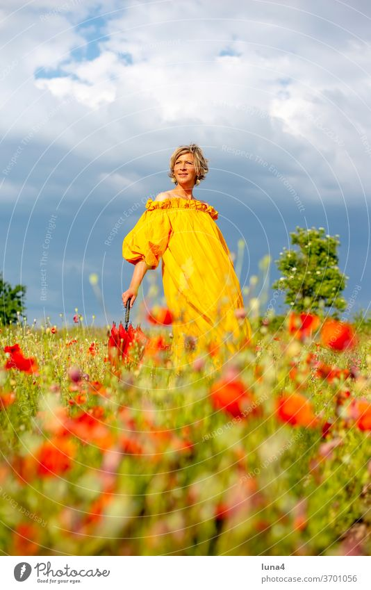 Woman with umbrella on flower meadow Poppy Umbrellas & Shades Laughter Young woman Poppy field Meadow Flower meadow stroll fortunate cheerful time-out luck Joy