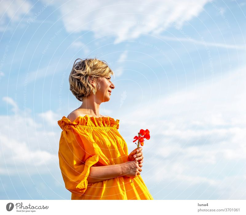 Woman with poppies Poppy Bouquet flowers Sun To enjoy sunbathe stop smile Laughter Young woman sensual daintily papaver fortunate cheerful time-out luck Joy