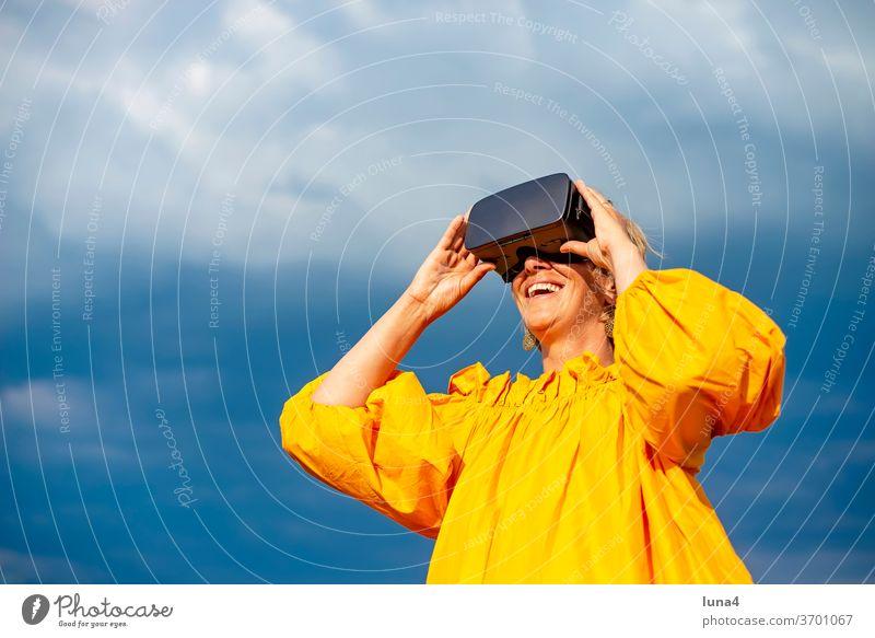 Woman with VR - glasses VR glasses virtual reality 3D 3D - glasses Eyeglasses virtual reality glasses look Virtual Cyberglasses Digital technology digitization