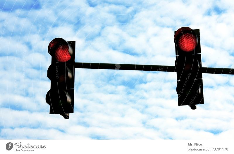 Red traffic light Traffic light red traffic light stop Transport Traffic infrastructure Road sign Road traffic Sky Clouds holds Light signal Stop Red light